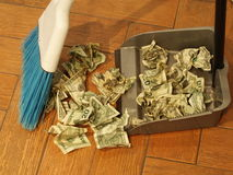 Money sweep 8. Photo of  a broom and dust pan sweeping up money Royalty Free Stock Images