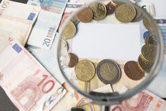 Money. On tabel trought a magnification glass Royalty Free Stock Photos