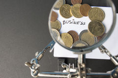 Money. On tabel trought a magnification glass Royalty Free Stock Photography