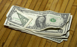 Money on Table. Bills on a wooden table stock photo