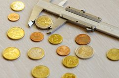 Money on a table. Coins, euro, cash, finance, instrument, caliper Royalty Free Stock Photo