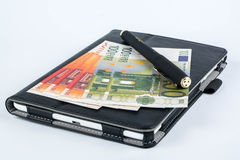 Money tablet and pen Stock Photo