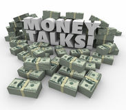 Money Talks Power Influence Financial Wealth Assets. Money Talks words in white 3d letters surrounded by staks or piles of dollars illustrating the power and Stock Image