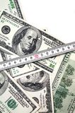 Money with tape measure Stock Photography