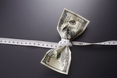 Money tape measure. Close up of the us currency and tape measure Stock Photos