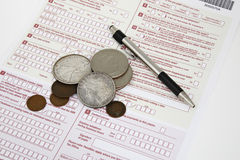 Money on the tax declaration. Blank tax declaration. Money and pen on the tax form Royalty Free Stock Photos