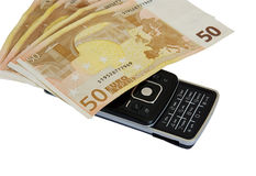 Money and telephone Stock Image