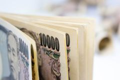 Money Ten Thousand Yen Banknote On White Background. Business And Finance Concepts Stock Photos