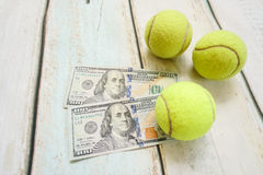 Money and tennis balls Royalty Free Stock Photos