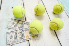 Money and tennis balls Stock Image
