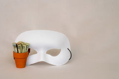 Money in terracotta pot with white mask Royalty Free Stock Photography