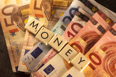 Money text on euro bills Royalty Free Stock Images