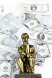 Money and Thinking Man Statue Stock Photos
