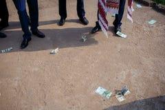 Money thrown to the ground Stock Image