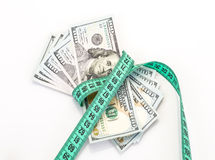 Money tied with measurement tape Stock Photo