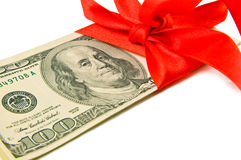 Money tied red ribbon for gift Royalty Free Stock Photography