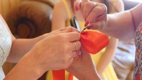 Money tied red ribbon. Ukrainian wedding tradition.  stock footage