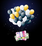 Money tied to balloon and floating Royalty Free Stock Photos