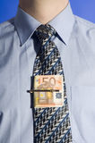Money tied to tie Royalty Free Stock Photography