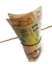 Money Tied Up With String. United Kingdom money tied up in investments. Wrapped in string on an isolated white background Royalty Free Stock Photo