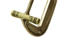Money is Tight. Money in a clamp vise royalty free stock images