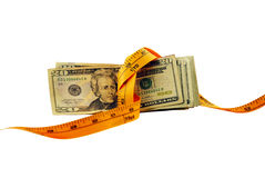 Money is Tight. In the form of many large bills with measuring tape pulling it together Stock Image