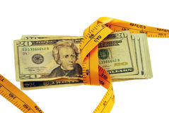Money is Tight. In the form of many large bills with measuring tape pulling it together Royalty Free Stock Images