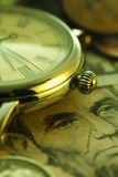 money time Klocka i US dollar - materielbild Royaltyfri Bild