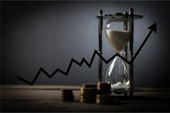 Money time. Investment savings sand timer royalty free stock photos