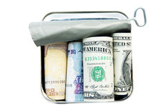 Money in tin can Royalty Free Stock Photography