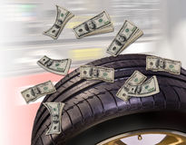 Money and Tires. Royalty Free Stock Images