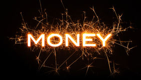 MONEY title word in glowing sparkler Royalty Free Stock Photos