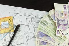 Money to build a house. Mortgage installment. Valid Czech banknotes. Part of architectural project, architectural plan, technical Royalty Free Stock Photos