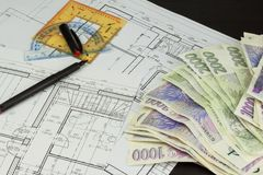 Money to build a house. Mortgage installment. Valid Czech banknotes. Part of architectural project, architectural plan, technical Royalty Free Stock Photo