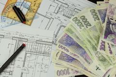 Money to build a house. Mortgage installment. Valid Czech banknotes. Part of architectural project, architectural plan, technical Royalty Free Stock Images
