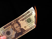 Money to Burn. Picture of someone burning a 20 dollar bill Royalty Free Stock Image