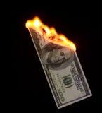 Money to burn. 100 dollar bill on fire Stock Photos