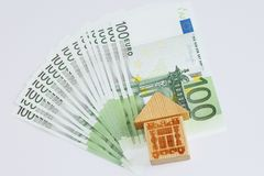 Money to pay off the loan. Money and house. Take the money in the bank for real estate royalty free stock photography