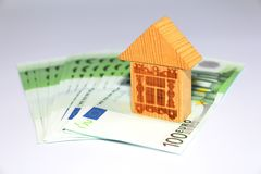 Money to pay off the loan. Money and house. Take the money in the bank for real estate royalty free stock images