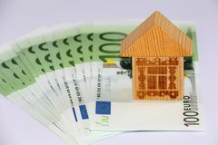 Money to pay off the loan. Money and house. Take the money in the bank for real estate stock photos