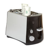 Money in toaster Royalty Free Stock Images