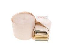 Money and toilet paper Stock Photos