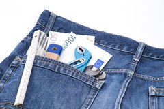 Money and tools in a pocket Stock Images