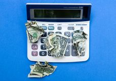 Money on top of calculator Stock Images
