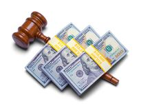 Money on Top Of Gavel. Stack of Money on Top of Judges Gavel Isolated on White Background Royalty Free Stock Image