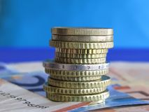 Money. A tower of euro coins over bank-notes Royalty Free Stock Photo