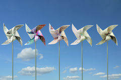 Money toy windmills Royalty Free Stock Photos