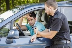 Money for traffic ticket. Young men does not have money for traffic ticket Stock Image