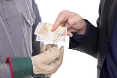 Money transfer. Businessman hands craftsmen with gloves money Royalty Free Stock Image