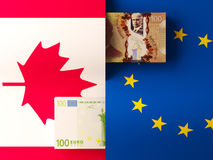 Money transfer between Canada and European Union Royalty Free Stock Image